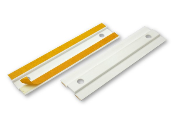 Self-adhesive cover plate for archive filing clips